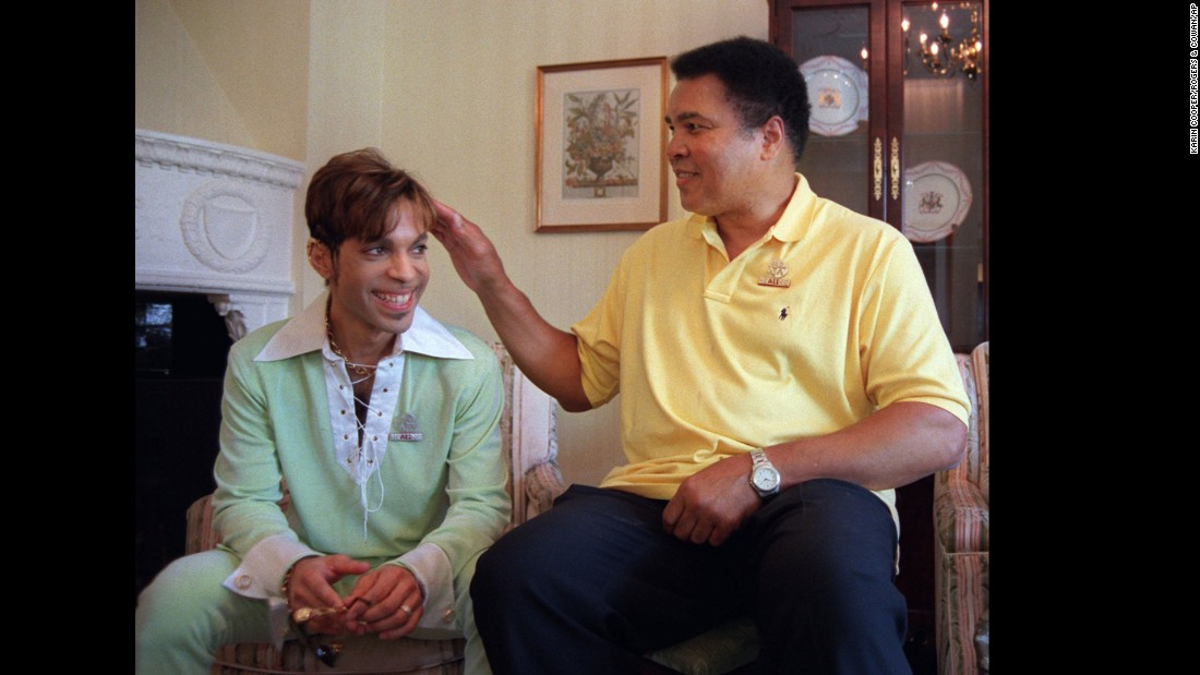 Muhammad Ali pats Prince's head prior to a news conference where they were to announce plans for a benefit concert in 1997.