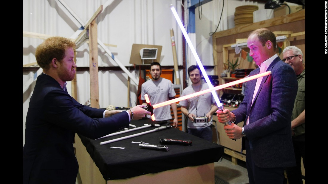 "Prince Harry, left, and Prince William, Duke of Cambridge, try out lightsabers during a tour of the ""Star Wars"" sets at Pinewood Studios on Tuesday, April 19, in Iver Heath, England. Prince William and Prince Harry are touring Pinewood Studios to visit the production workshops and meet the creative teams working behind the scenes on the ""Star Wars"" films."