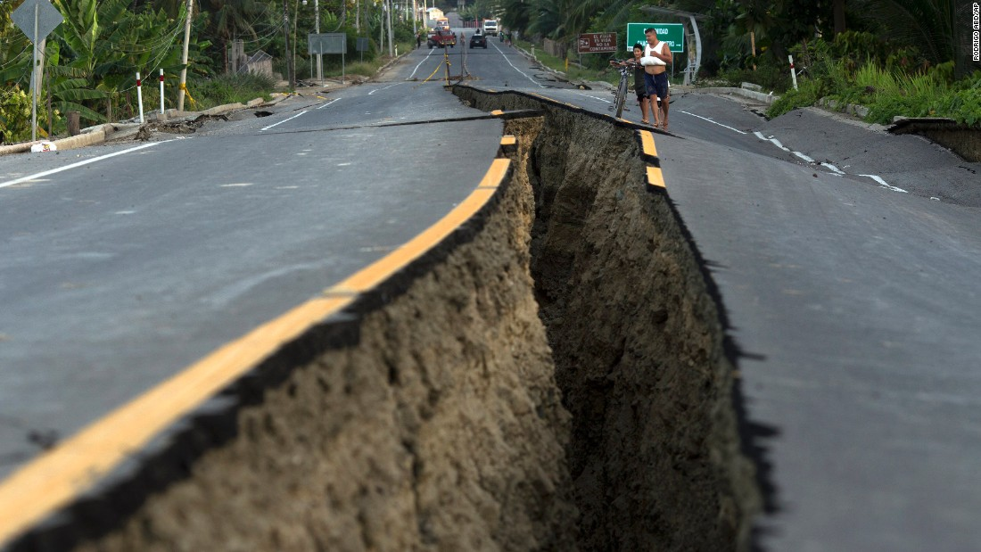 "Residents look at a rift in the highway created by a <a href=""http://www.cnn.com/2016/04/20/americas/ecuador-earthquake/index.html"" target=""_blank"">7.8-magnitude earthquake</a>, in Chacras, Ecuador, on Tuesday, April 19. The strongest earthquake to hit Ecuador in decades flattened buildings and buckled highways along its Pacific coast, sending the nation into a state of emergency."