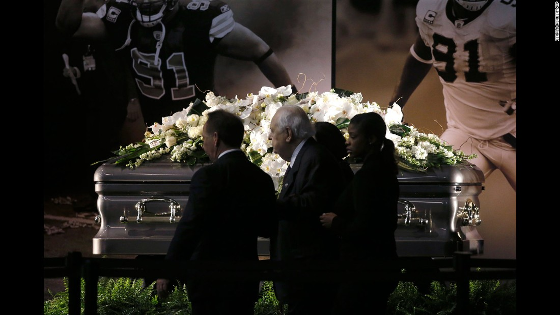 "New Orleans Saints owner Tom Benson and his wife, Gayle Benson, view the casket of <a href=""http://www.cnn.com/2016/04/21/us/will-smith-shooting-up-to-speed/"" target=""_blank"">former Saints defensive end Will Smith</a> during a public viewing inside the Saints training facility in Metairie, Louisiana, on Friday, April 15.  Smith was shot to death this past Saturday, and his wife wounded by gunfire, after an altercation following a traffic accident."