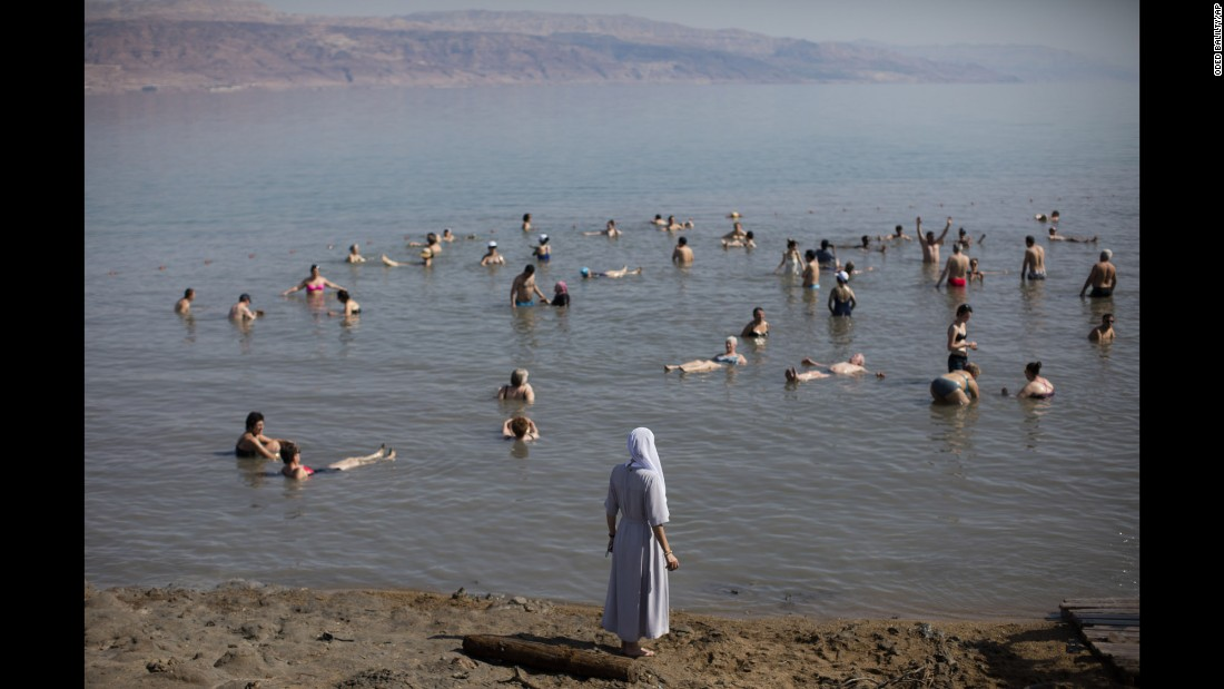 """Tourists float in the Dead Sea in Israel on Friday, April 15. <a href=""""http://www.cnn.com/2016/04/15/world/gallery/week-in-photos-0415/index.html"""" target=""""_blank"""">See last week in 37 photos</a>"""
