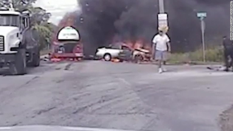 Woman trapped in burning car