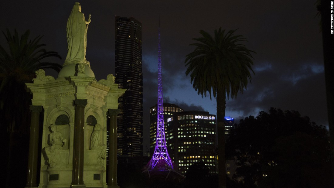 The Melbourne Arts center spire lights up in purple on April 22.
