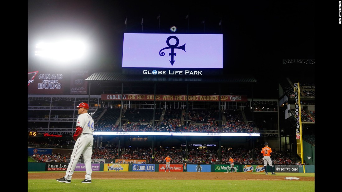 Prince's symbol is broadcast on the Texas Rangers video screen over the right field roof during a game between the Rangers and Houston Astros in Arlington, Texas.