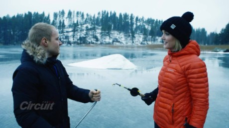 Valtteri Bottas demonstrates ice fishing to The Circuit presenter Amanda Davies.