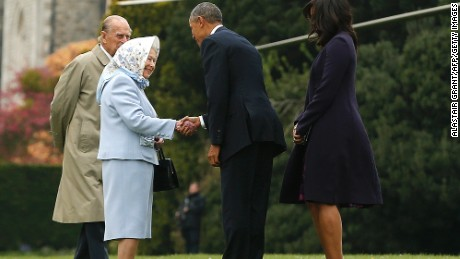 US President Barack Obama and his wife US First Lady Michelle Obama are greeted by Britain's Queen Elizabeth II and Prince Philip, Duke of Edinburgh, after landing by helicopter at Windsor Castle for a private lunch in Windsor, southern England, on April, 22, 2016.