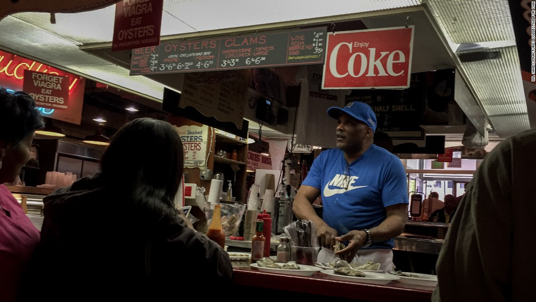 A man serves raw oysters in Baltimore's famous Lexington Market. In recent years the city has invested heavily in  tourism, hoping to attract external dollars to the city.