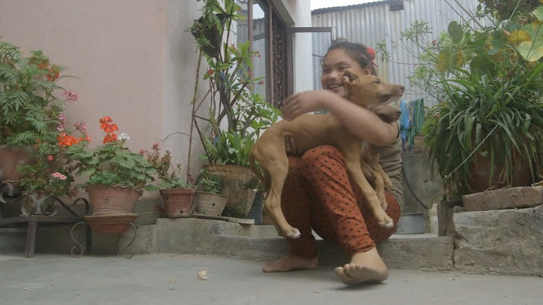 Nepal earthquake anniversary girl leg Kathmandu ns orig_00015209