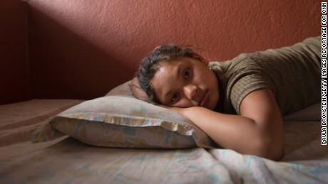 Maya Gurung, 11, poses inside her foster home in Kathmandu.