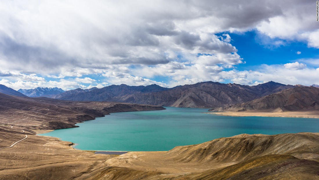 Vast Bulunkul Lake spreads across the Tajik landscape.