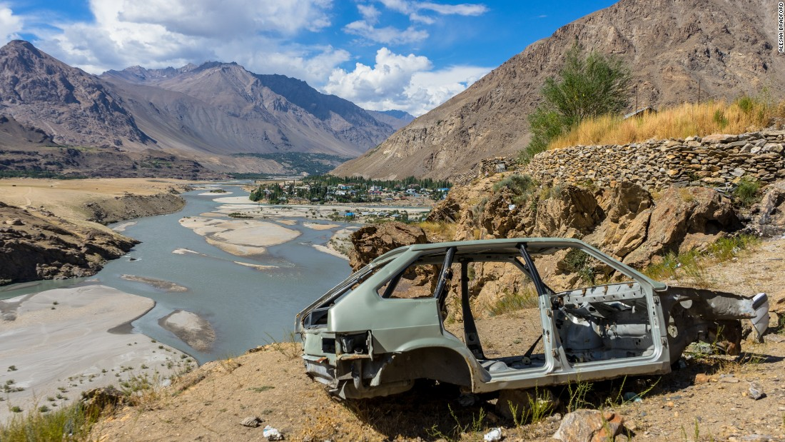 The shell of a car sits on a viewpoint of Khorog, a small town in the Gorno-Badakhshan Autonomous Region of Tajikistan.