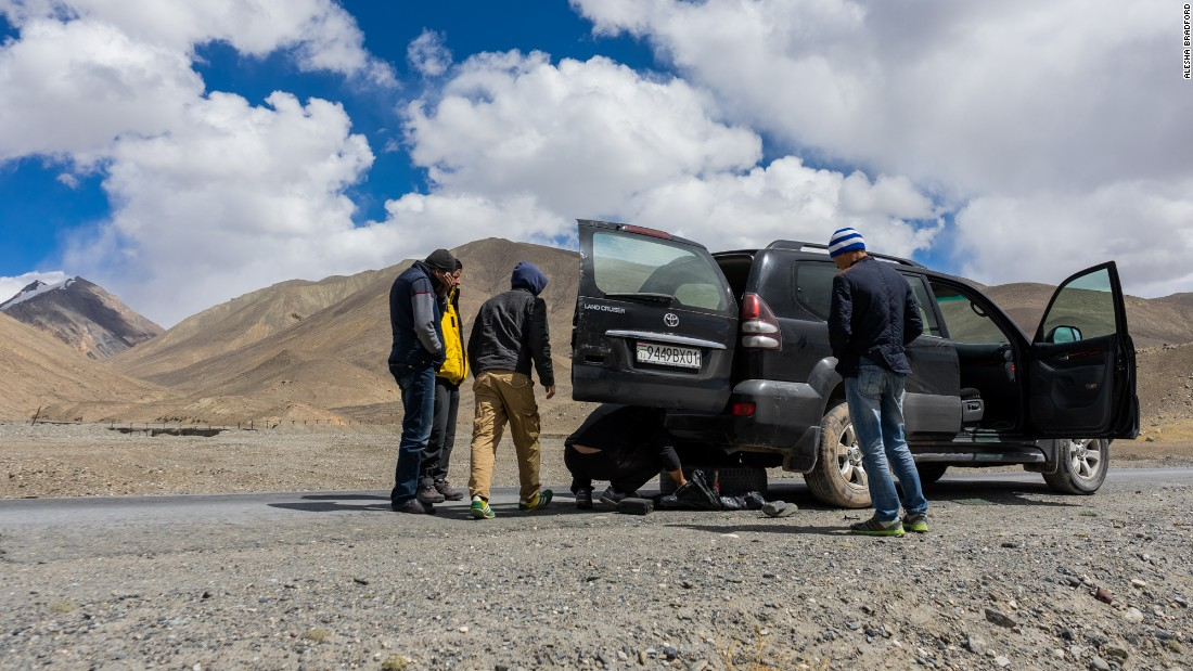 Breakdowns and flat tires are common on the Pamir Highway, but people will always stop to lend a helping hand.