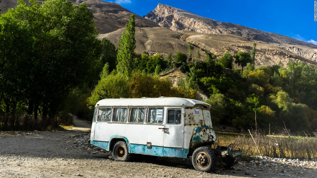 A broken down bus has been turned into a shop outside the Tajikistan village of Yamg. It's become a familiar way point on the Pamir Highway.