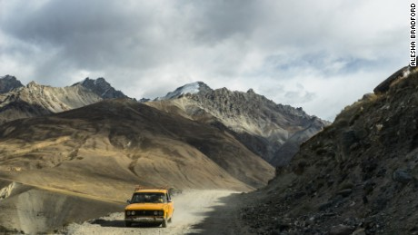 Old Car Driving Pamir Highway: The road turns into rough, and at times dangerous dirt and gravel, when entering the Wakhan Corridor.