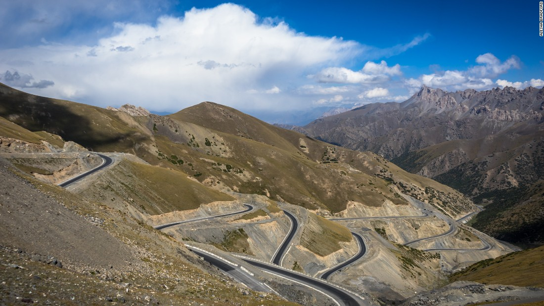A new section of the Pamir Highway winds up a steep mountain in Kyrgyzstan.