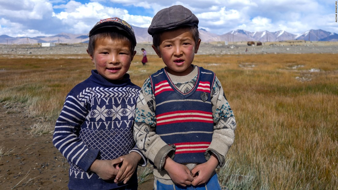 These stylish Karakul Lake boys chased the author down to have their picture taken, a common experience on the Pamir Highway.