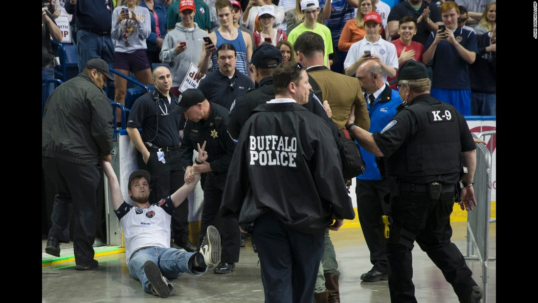 Security removes protesters as Republican presidential candidate Donald Trump speaks during a campaign stop at the First Niagara Center on Monday, April 18, in Buffalo, New York.