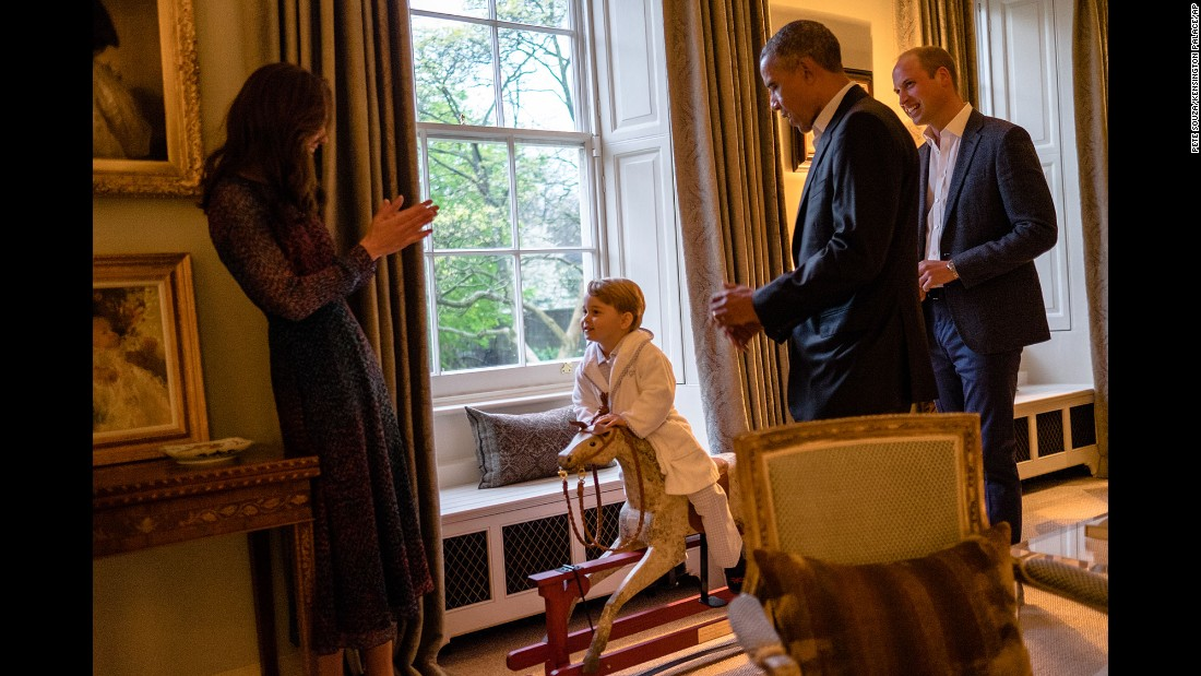 Catherine, the Duchess of Cambridge, Prince George and Prince William talk with U.S. President Barack Obama at Kensington Palace in London on Friday, April 22.  Obama visited the royals during his global tour, with stops in Saudi Arabia, Britain and Germany.