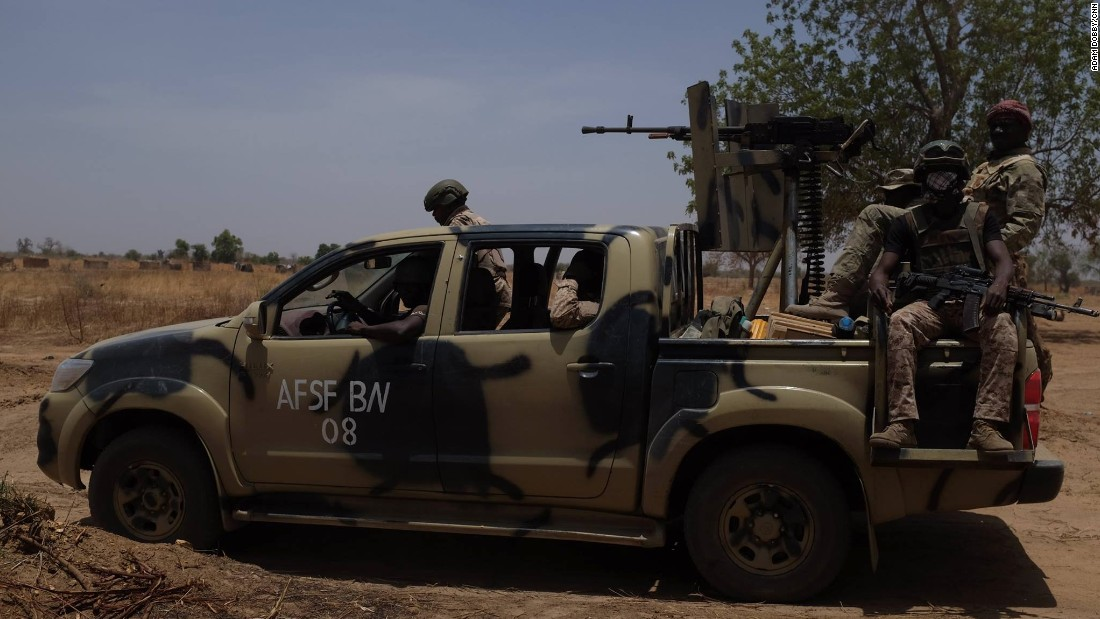 A vehicle full of troops scans the horizon scouting for any indication of insurgent presence.
