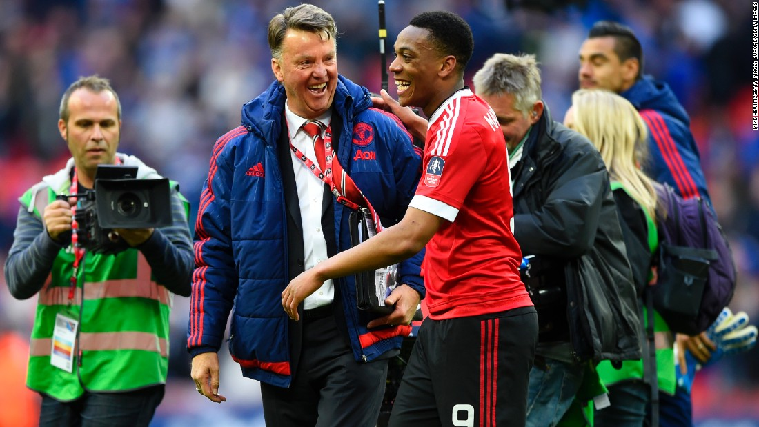United manager, Louis van Gaal, celebrates with Martial after the final whistle.
