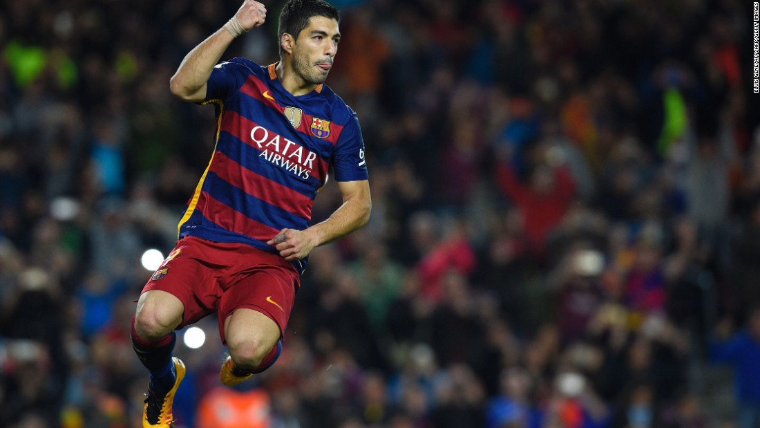 Luis Suarez celebrates scoring in Barcelona's 6-0 La Liga win over Sporting Gijon.