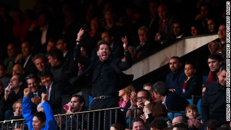 Diego Simeone enocourages the crowd from the stand after being sent off during Atletico Madrid's match with Malaga.
