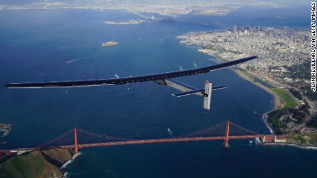 Solar Impulse 2, a solar powered plane, flies over the Golden Gate Bridge in San Francisco on Saturday, April 23.