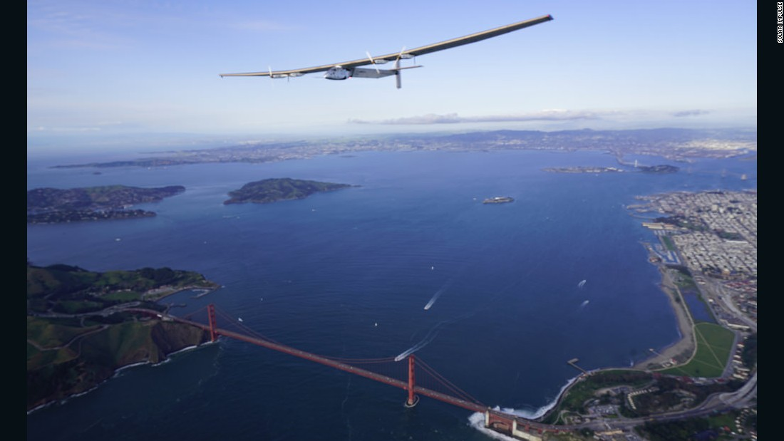 Solar Impulse 2 flies over the Golden Gate Bridge as part of a fly-by of the San Francisco Bay after flying for two and half days from Hawaii.