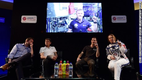 British astronaut Tim Peake, on screen, speaks at a news conference ahead of the London Marathon.