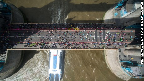 Runners cross the River Thames over Tower Bridge during the London Marathon on Sunday, April 24.