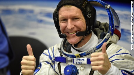Britain's astronaut Tim Peake gestures as his space suit is tested at the Russian-leased Baikonur cosmodrome, prior to blasting off to the International Space Station (ISS), on December 15, 2015. Russia's Soyuz TMA-19M spacecraft carrying the International Space Station (ISS) Expedition 46/47 crew of Britain's astronaut Tim Peake, Russian cosmonaut Yuri Malenchenko and US astronaut Tim Kopra is scheduled to blast off to the ISS on December 15, 2015. AFP PHOTO / KIRILL KUDRYAVTSEV / AFP / KIRILL KUDRYAVTSEV        (Photo credit should read KIRILL KUDRYAVTSEV/AFP/Getty Images)