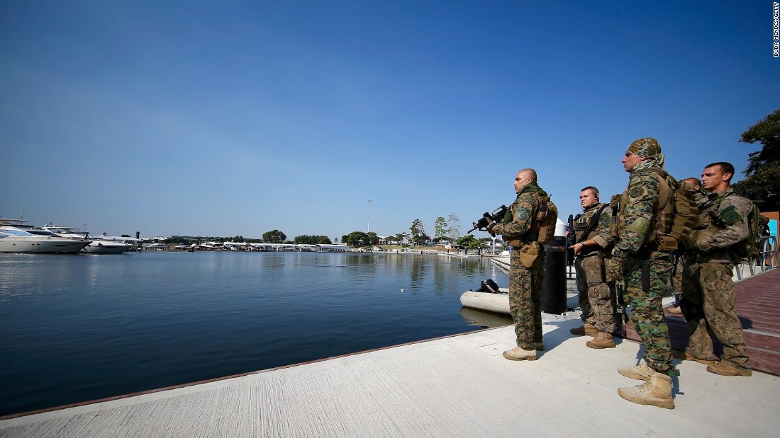 Members of Brazil's military police at the marina which will be home to Olympic sailing events. Water pollution at this venue and security concerns are just two of the issues Rio organizers face.