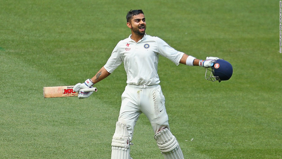 An exuberant Kohli celebrates reaching his century during day three of the Third Test match between Australia and India at Melbourne Cricket Ground on December 28, 2014 in Melbourne, Australia.
