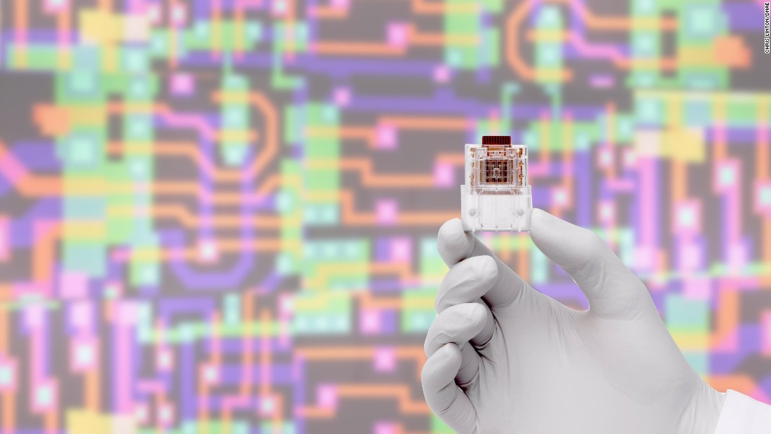 "Professor Chris Toumazou pioneered a wave of multidisciplinary study and discovery within electronics, biology, genetics and health care -- including his ""lab-on-a-chip,"" pictured."
