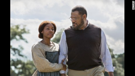 "The rebooted miniseries ""Roots"" debuted Monday with Anika Noni Rose, who plays Kizzy, and Laurence Fishburne as Alex Haley."