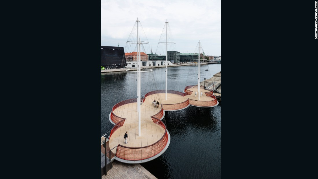 "Artist <a href=""http://www.olafureliasson.net/"" target=""_blank"">Olafur Eliasson</a> was inspired by the city's history as a port town when he designed Cirkelbroen. The five round platforms and wired masts give the illusion of boats floating on the harbor."