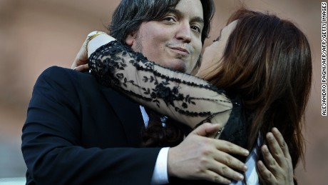 Argentina's reelected President Cristina Fernandez de Kirchner (R) is embraces by her son Maximo, during her inauguration ceremony, in Mayo square, Buenos Aires on December 10, 2011. President Cristina Kirchner was sworn in Saturday to a second four-year term at the peak of her popularity but with the country's booming economy shadowed by Europe's financial crisis. AFP PHOTO / Alejandro Pagni        (Photo credit should read ALEJANDRO PAGNI/AFP/Getty Images)