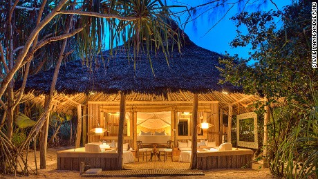 Mnemba Island's guests stay in luxury versions of traditional beachside bandas.