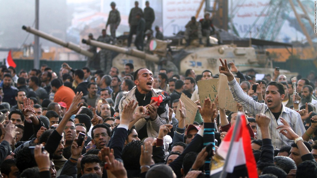 Egyptians protest in front of an army tank in Cairo in January 2011. Inspired by protests that ousted Tunisia's oppressive leader, tens of thousands of Egyptians demonstrated for an end to the 30-year rule of President Hosni Mubarak.