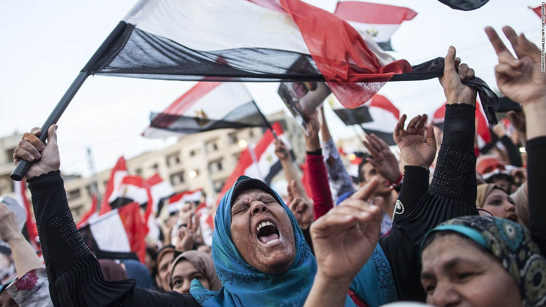 Egyptians celebrate in front of the presidential palace in Cairo in June 2014 after former military chief Abdel Fattah el-Sisi wins a new presidential election.