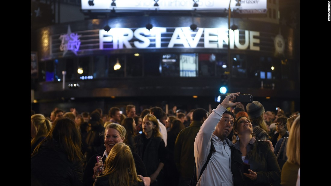 "People take a selfie in front of First Avenue, the Minneapolis nightclub featured in the movie ""Purple Rain,"" on Thursday, April 21. Prince, the iconic musician who starred in the film, <a href=""http://www.cnn.com/2016/04/21/entertainment/gallery/prince-rogers-nelson/index.html"" target=""_blank"">died earlier in the day.</a> He was 57."