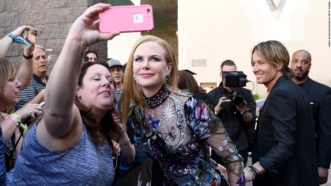 Actress Nicole Kidman poses for a fan's photo at the Academy of Country Music Awards on Sunday, April 3.