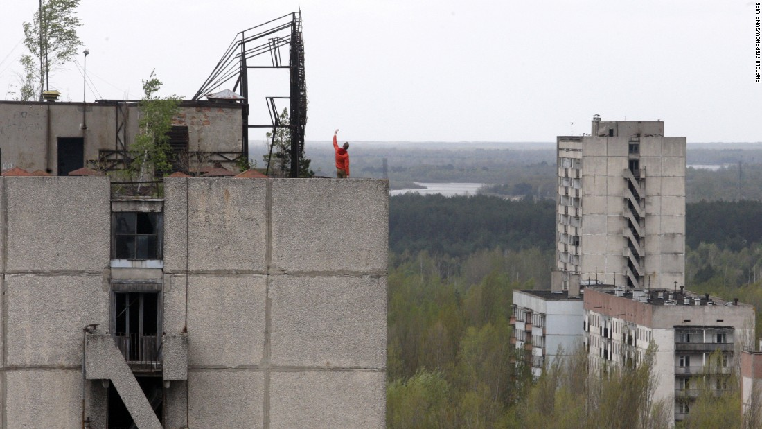 "A man takes a selfie on the roof of an abandoned building in Pripyat, Ukraine, on Friday, April 22. Workers of the Chernobyl nuclear plant lived there 30 years ago, before an explosion<a href=""http://www.cnn.com/2016/04/25/world/containing-chernobyl-dome-anniversary-radiation/"" target=""_blank""> tore through a reactor</a> in April 1986."