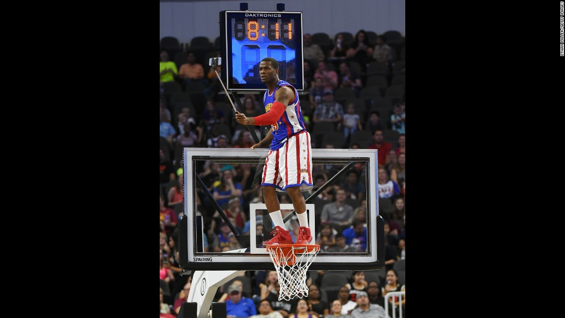 "Saul ""Flip"" White, a member of the Harlem Globetrotters, uses a selfie stick during an exhibition game in Las Vegas on Tuesday, April 19."