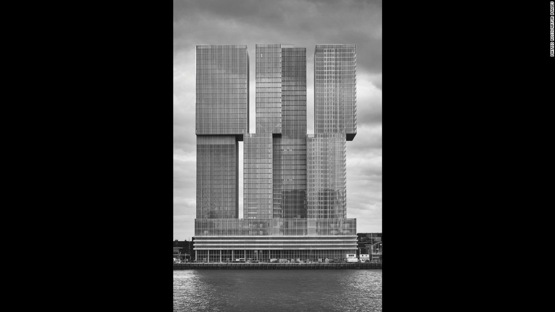 "Chadwick argues that Rem Koolhaas' De Rotterdam is another example of contemporary architecture riffing on aesthetics more than half a century old. In essence, he says a Brutalist building is one ""avoiding unnecessary details... with a strong form and a lot of straight lines and faceless facades... It's bold, it's domineering; it's an indication that it's aesthetically different with it's surroundings."""