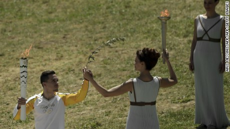 Actress Katerina Lechou acting the high pristess holds a torch with the Olympic flame at the Temple of Hera on April 21, 2016 during the lighting ceremony of the Olympic flame in ancient Olympia, the sanctuary where the Olympic Games were born in 776 BC.  The Olympic flame was lit today and solemnly sent off carrying international hopes that Brazil's political paralysis will not taint the Rio Games that start in barely 100 days. / AFP / ARIS MESSINIS        (Photo credit should read ARIS MESSINIS/AFP/Getty Images)