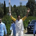 Rio 2016 Torchbearer Giovane Cavio runs with the Olympic flame