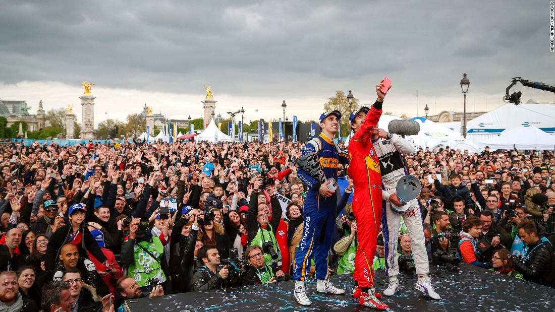Di Grassi -- center -- takes a selfie with runner up Sebastien Buemi (left) and Jean Eric Vergne at the Paris podium ceremony in front of a throng of excited fans.