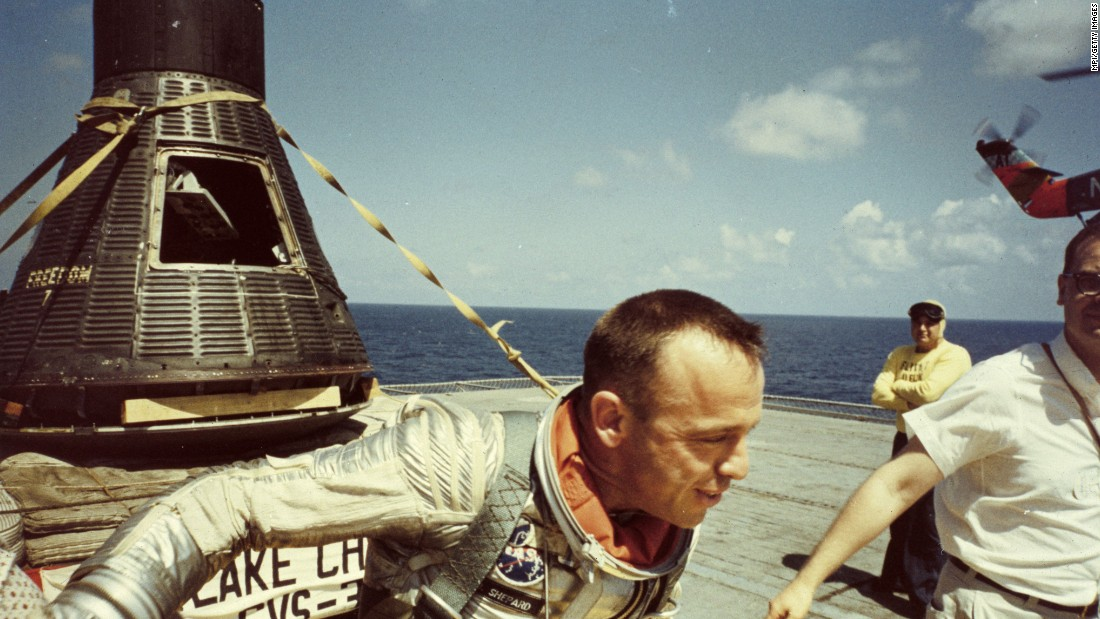"Shepard walks on the USS Lake Champlain after his landing. President Kennedy awarded him the Distinguished Service Medal one day later, and a ticker-tape parade drew 250,000 people in Washington. Decades later, Glenn recalled the significance of Shepard's accomplishment. ""We had been beaten in the early days of the space race by a country that bragged (by saying) America now sleeps under a Soviet moon. But Al brought us back."""