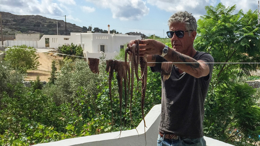 Anthony Bourdain strings up fresh octopus Naxian style to dry it out before cooking.